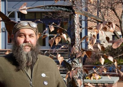 "CCKAP Artisan Erin Aylor in front of his ""Three Little Birds"" kinetic sculpture (Photo Bill Green - FNP Photographer)"